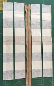 Marquage de repères sur les bandes rayées et le zip.