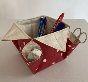 Vide poche ou organiseur qui recoit des stylos et crayons..