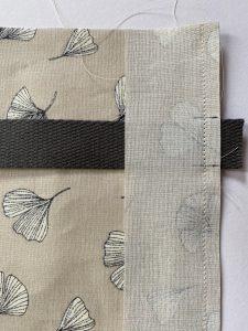 Detalhe costura fita cinta e sacola sacola e mochila.